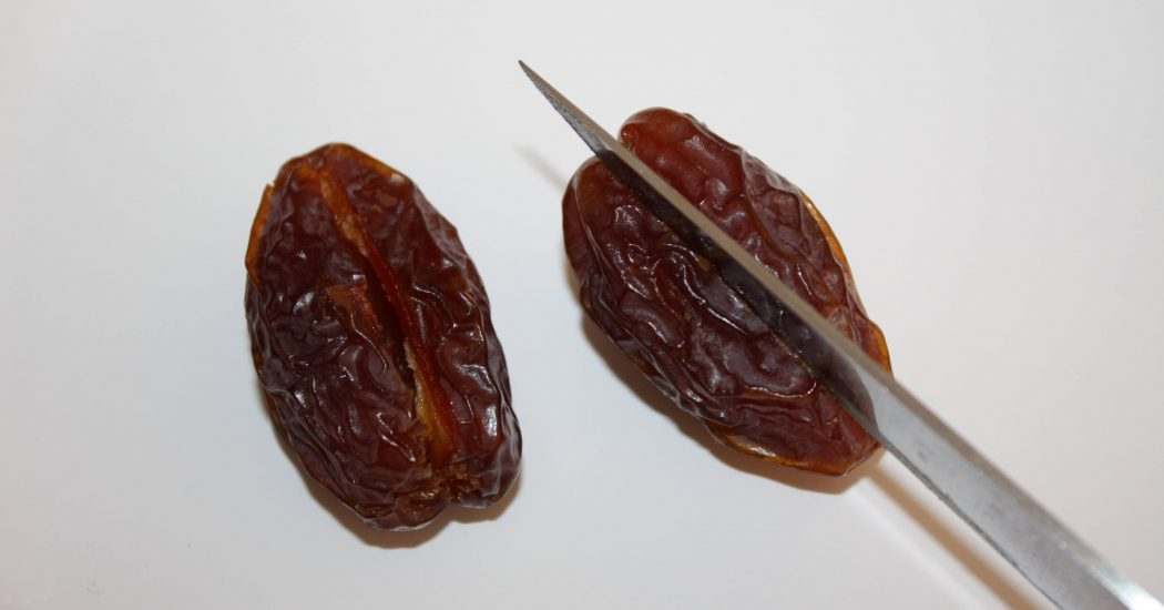 Slice dates lengthwise to remove pit