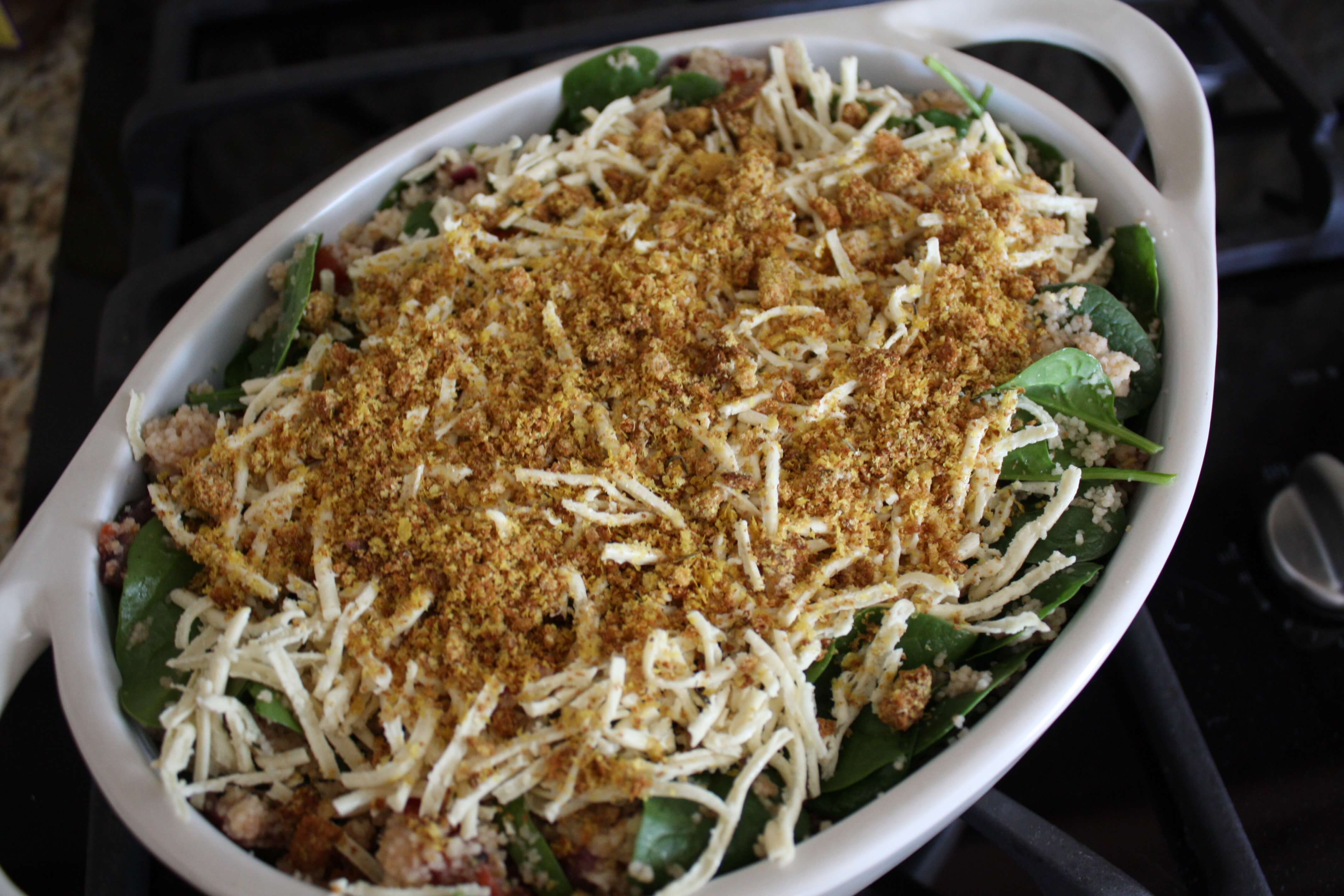Sprinkle with cheese and top evenly with breadcrumbs